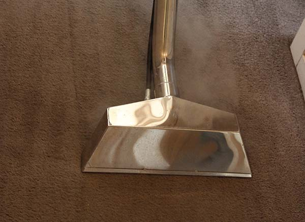 Carpet Cleaning Melbourne - Steam Cleaning Wand cleaning carpet