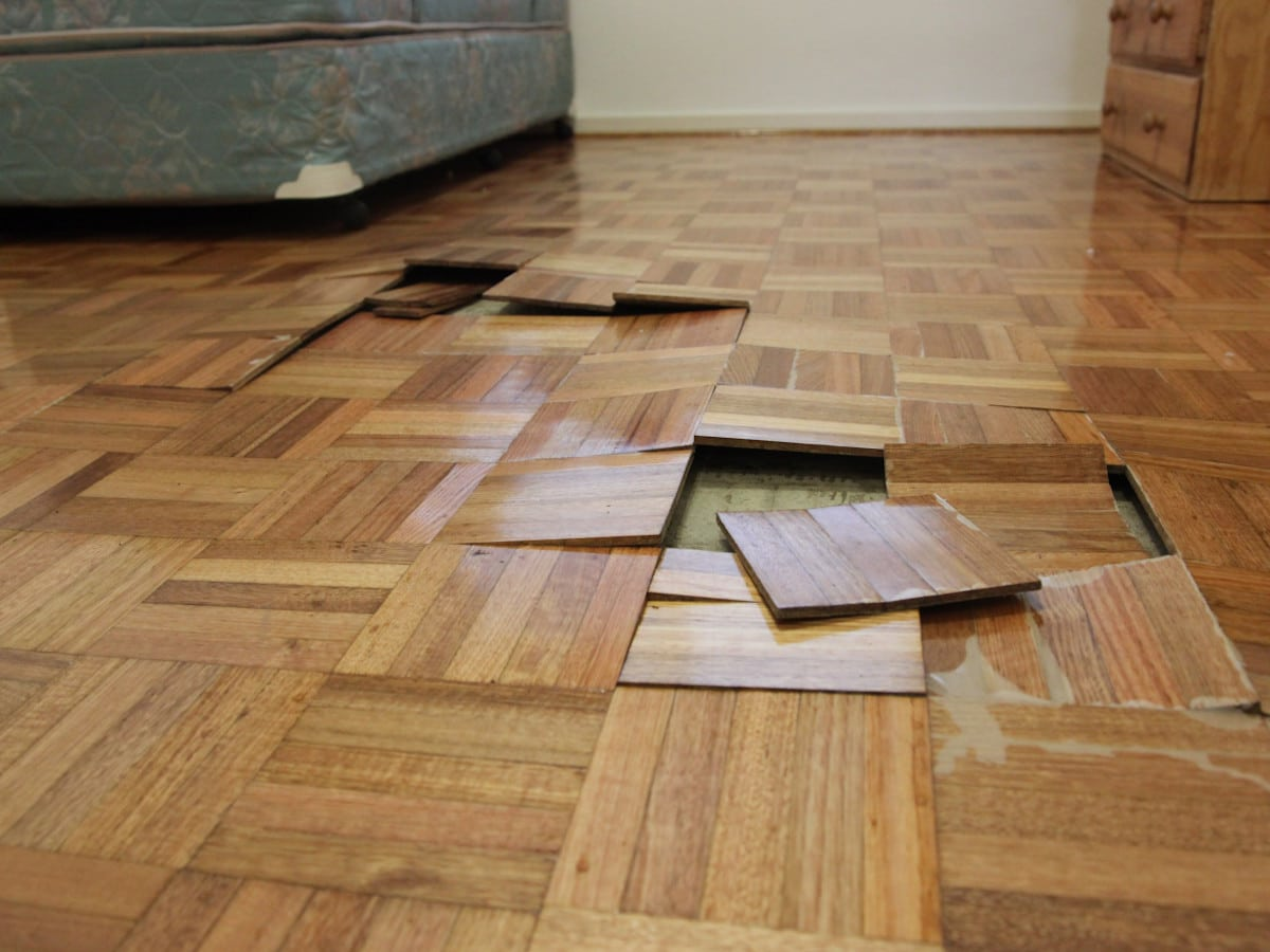 Water Damage Restoration Melbourne - Parquetry floor coming apart after flooding