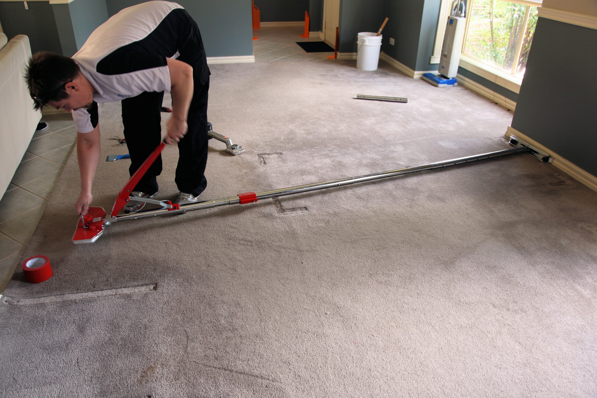 Doing a restretching carpet repair Melbourne. Re-Stretching
