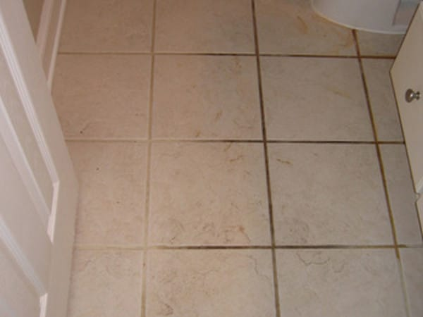 Before grout colour seal Melbourne, the stains in the grout of these bathroom tiles is permanent before
